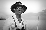 A fisherman at the Malecón in Havana in the early morning.