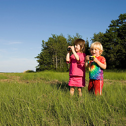 Kids studying nature in Plum Island Sound in Rowley Massachusetts USA