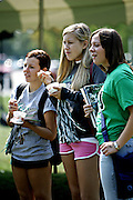 17083Ice Cream Front Four Scudents Outside : Photos by Michael Rubenstein..Freshman Lauren Vandermark, Jenna Miller and Elizabeth Kness eat ice cream at the Student Alumni Board Ice Cream Social on Friday, September 9th 2005.