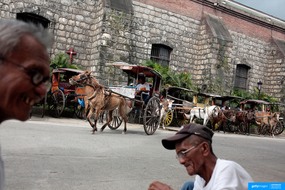 A street scene in Vigan, a spanish colonial town in the Philippines, it is a World Heritage Site and is the most intact example of a Spanish colonial town in the Philippines, and is well-known for its cobblestone streets, September 25, 2008. Photo Tim Clayton