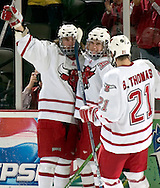 2/4/06 -- Omaha, Ne.From left: University of Nebraska at Omaha's Phil Angell, Scott Parse and Bill Thomas celebrate Parse.s game tying goal against Lake Superior State Saturday night. It was Parse's 17th goal and 51st point on the season...(Photo by Chris Machian/Prarie Pixel Group).