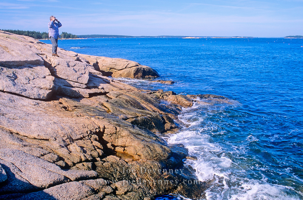 Woman looking out to sea. Great Wass island, Maine