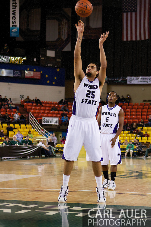 November 27th, 2010:  Anchorage, Alaska - Weber State freshman forward Byron Fulton (25) attempts a free throw in the Weber State 82-81 victory over the Drake Bulldogs in the third place game of the Great Alaska Shootout.