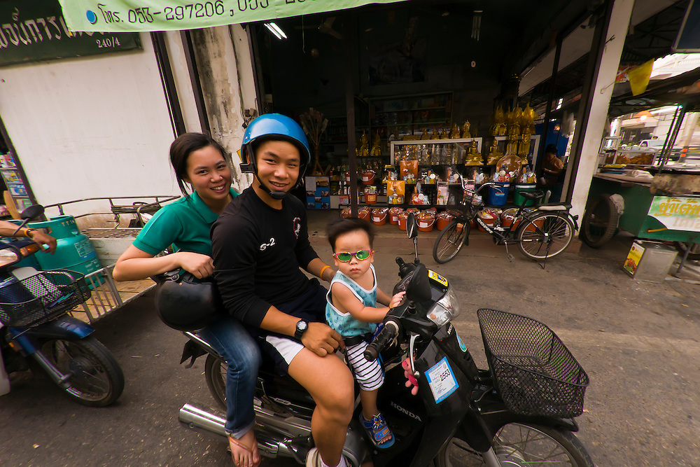 Thai family on a motorscooter, Chiang Mai, Northern Thailand