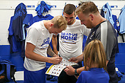 AFC Wimbledon midfielder Mitchell (Mitch) Pinnock (11) signing programme in Lead us home T shirt during the EFL Sky Bet League 1 match between AFC Wimbledon and Accrington Stanley at the Cherry Red Records Stadium, Kingston, England on 17 August 2019.