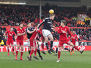 17th March 2018, Pittodrie Stadium, Aberdeen, Scotland; Scottish Premier League football, Aberdeen versus Dundee; Kevin Holt of Dundee competes in the air with Chidiebere Nwakali and Ryan Christie of Aberdeen