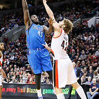 07 December 2013: Dallas Mavericks center DeJuan Blair (45) goes for the skyhook over Portland Trail Blazers center Robin Lopez (42) during the Dallas Mavericks 108-106 victory over the Portland Trail Blazers at the Moda Center, Portland, Oregon, USA.