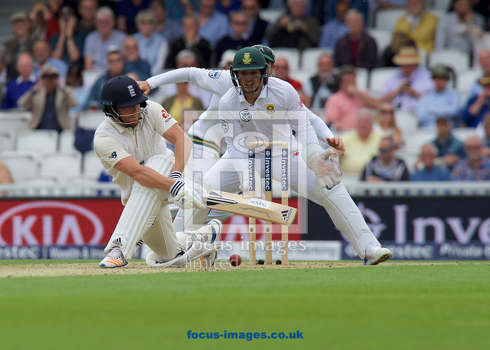 Jonny Bairstow of England plays a sweep shot watched by Wicketkeeper Quinton de Kock of South Africa  during the 100th Investec Test Match match at the Kia Oval, London<br /> Picture by Alan Stanford/Focus Images Ltd +44 7915 056117<br /> 28/07/2017