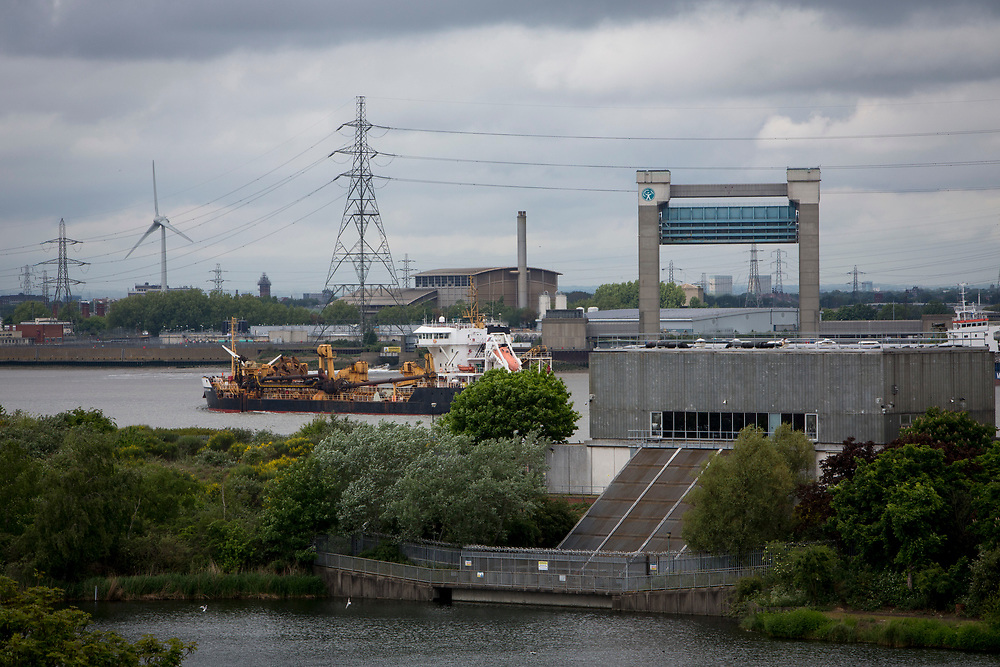 A ship passes by Central Way Pumping station, protecting homes from flooding, Thamesmere lake (lake 4), next to Thamesmere leisure centre. Thamesmead, London.  (photo by Andrew Aitchison / In pictures via Getty Images)