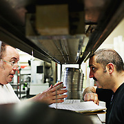 Chef Scott Howell talks with pastry chef Eric Akbari at Nana's on July 6, 2016.