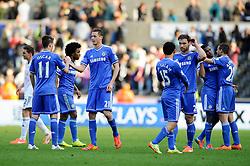 Nemanja Matic (SRB) of Chelsea congratulates Oscar (BRA) as chelsea players celebrate but look relieved to secure an unconvincing 0-1 win - Photo mandatory by-line: Rogan Thomson/JMP - 07966 386802 - 13/04/2014 - SPORT - FOOTBALL - Liberty Stadium, Swansea -  Swansea City v Chelsea FC - Barclays Premier League.