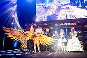 UNITED KINGDOM, London: 25 May 2019 <br /> The winning cosplayer, Calley Macleod dressed as a Firebird Mount from Final Fantasy XIV, walks on stage to collect her certificate at the Championships of Cosplay at MCM London Comic Con this year. The three day comic convention is being held at London ExCeL from Fri 24th - Sun 26th of May.