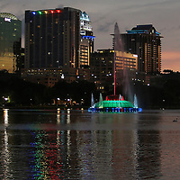The fountain at Lake Eola Park is lit with rainbow colors in memory of the victims of the Pulse nightclub where many victims were killed in the deadliest shooting in modern U.S. History on Tuesday, June 14, 2016, in Orlando, Fla. (Alex Menendez via AP)