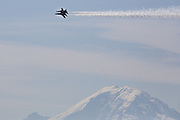 The U.S. Navy Blue Angels practice their routine over Mount Rainier, as viewed from Homer M. Hadley Memorial Bridge in Seattle, Washington. <br /> <br /> Maddie Meyer / The Seattle Times