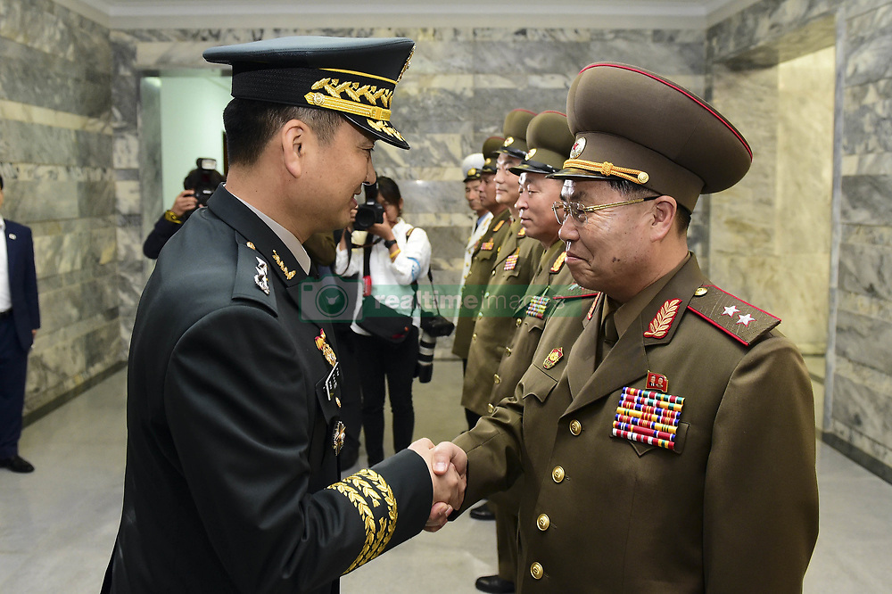 June 14, 2018 - Panmungak, North Korea - North Korean and South Korean Military delegates meet during an Inter-Korean Military talk at Panmungak, North Korea. South and North Korea are holding their first high-level military talks in more than 10 years to discuss ways to ease cross-border tensions. The meeting started at 10 a.m. on the northern side of the truce village of Panmunjom, according to Seoul's defense ministry. These were the first such talks since the two sides met in December 2007.  (Credit Image: © Ryu Seung-Il via ZUMA Wire)