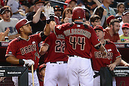May 15, 2016; Phoenix, AZ, USA; Arizona Diamondbacks Paul Goldschmidt (44) is congratulated after hitting a sacrifice fly in the fourth inning against the San Francisco Giants at Chase Field. Mandatory Credit: Jennifer Stewart-USA TODAY Sports
