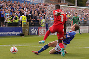Carlisle United defender Tom Miller tackles York City defender Femi Illesami during the Sky Bet League 2 match between York City and Carlisle United at Bootham Crescent, York, England on 19 September 2015. Photo by Simon Davies.