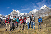 "Trekkers at Mitucocha lake (4270 m), Nevado Jirishanca (""Icy Beak of the Hummingbird"" 6094 m), Nevado Rondoy (right 5870 m). Day 2 of 9 days trekking around the Cordillera Huayhuash in the Andes Mountains, Peru, South America."