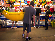 "01 SEPTEMBER 2011 - ST. PAUL, MN:  People walk through the midway at the Minnesota State Fair. The Minnesota State Fair is one of the largest state fairs in the United States. It's called ""the Great Minnesota Get Together"" and includes numerous agricultural exhibits, a vast midway with rides and games, horse shows and rodeos. Nearly two million people a year visit the fair, which is located in St. Paul.   PHOTO BY JACK KURTZ"