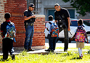 Three school children approach two Chicago Police officers Reyes Sanjuanero after a violent incident near Penn Elementary School in 1600 block of S. Avers in Chicago on Thursday, May 29, 2014. B583767330Z.1 (Scott Strazzante/Chicago Tribune)<br /> <br /> A man was shot and seriously wounded near a Lawndale school this afternoon, one of several shootings that left one person dead and five others wounded on the South and West Sides today, officials said.<br /> <br /> The man was shot around 3 p.m. across the street from Penn Elementary School, 1616 S. Avers Ave., according to Fire Department spokesman Larry Langford. The man was wounded in the chest and taken to Mount Sinai Hospital in serious-to-critical condition, he said.<br /> <br /> Langford gave the victim's age as 20, but police said he is 18.<br /> <br /> ....OUTSIDE TRIBUNE CO.- NO MAGS,  NO SALES, NO INTERNET, NO TV, CHICAGO OUT, NO DIGITAL MANIPULATION...