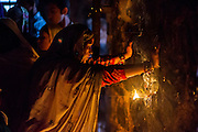 "19th November 2015, New Delhi, India.  A woman prays at a shrine dedicated to Djinn worship in the ruins of Feroz Shah Kotla in New Delhi, India on the 19th November 2015<br /> <br /> PHOTOGRAPH BY AND COPYRIGHT OF SIMON DE TREY-WHITE a photographer in delhi<br /> + 91 98103 99809. Email: simon@simondetreywhite.com<br /> <br /> People have been coming to Firoz Shah Kotla to pray to and leave written notes and offerings for Djinns in the hopes of getting wishes granted since the late 1970's. Jinn, jann or djinn are supernatural creatures in Islamic mythology as well as pre-Islamic Arabian mythology. They are mentioned frequently in the Quran  and other Islamic texts and inhabit an unseen world called Djinnestan. In Islamic theology jinn are said to be creatures with free will, made from smokeless fire by Allah as humans were made of clay, among other things. According to the Quran, jinn have free will, and Iblīs abused this freedom in front of Allah by refusing to bow to Adam when Allah ordered angels and jinn to do so. For disobeying Allah, Iblīs was expelled from Paradise and called ""Shayṭān"" (Satan).They are usually invisible to humans, but humans do appear clearly to jinn, as they can possess them. Like humans, jinn will also be judged on the Day of Judgment and will be sent to Paradise or Hell according to their deeds. Feroz Shah Tughlaq (r. 1351–88), the Sultan of Delhi, established the fortified city of Ferozabad in 1354, as the new capital of the Delhi Sultanate, and included in it the site of the present Feroz Shah Kotla. Kotla literally means fortress or citadel."