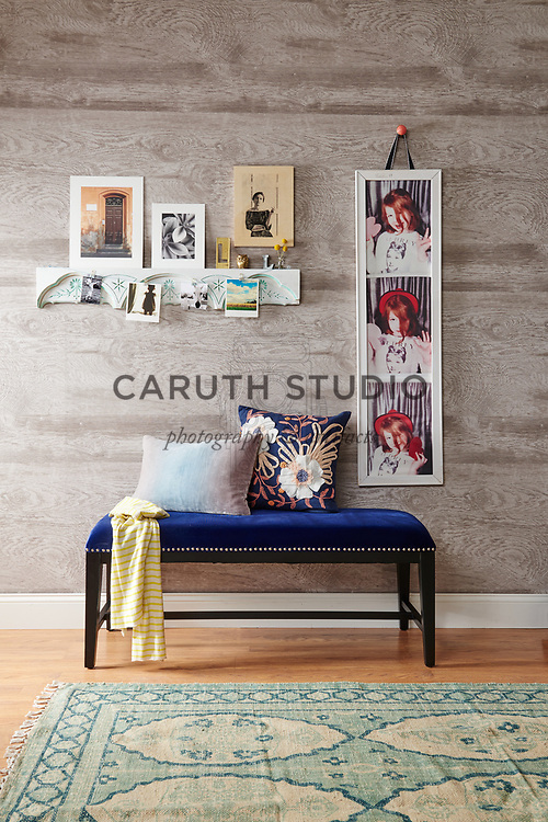 Framed photo booth images, photographs and wood transfer on architectural salvage above entry bench