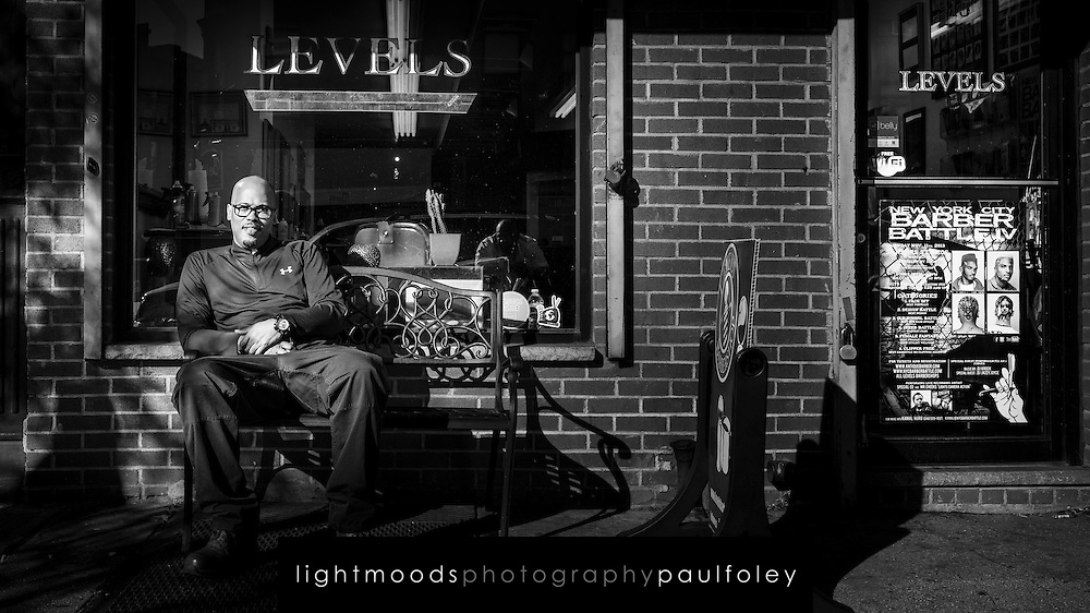 Charles sitting outside Levels Barber Shop, Fulton Street, Brooklyn, NY