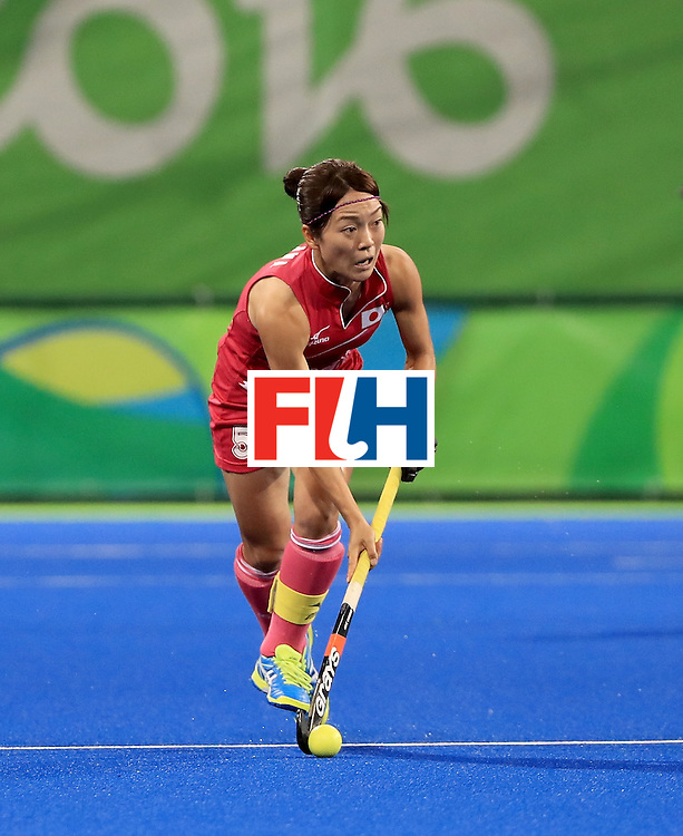 RIO DE JANEIRO, BRAZIL - AUGUST 11:  Miyuki Nakagawa #5 of Japan runs with the ball during a Women's Preliminary Pool B match against Great Britain at the Olympic Hockey Centre on August 11, 2016 in Rio de Janeiro, Brazil.  (Photo by Sam Greenwood/Getty Images)