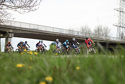 The peloton sweep around a corner at Healthy Ageing Tour 2019 - Stage 3, a 124 km road race starting and finishing in Musselkanaal, Netherlands on April 12, 2019. Photo by Sean Robinson/velofocus.com