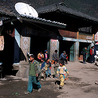 "TACHENG, DECEMBER 18, 2000:  cildren walk past one of the numerous ""Shangri-La"" hotels in north-east Yunnan province , December 18, 2000..Since the beginning of the controversy about the ""real"" Shangri-La in the mid-nineties, clever businessmen have profited from the situation by labeling their products after the famous paradise-like place that's decribed in "" lost Horizon""-by James Hilton.. ."