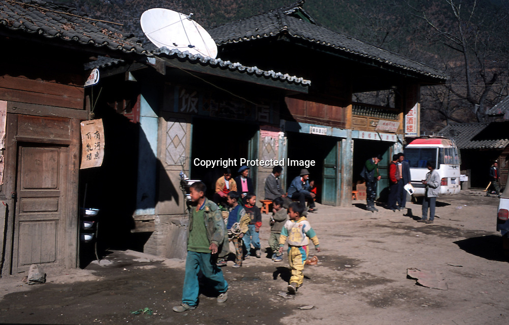 """TACHENG, DECEMBER 18, 2000:  cildren walk past one of the numerous """"Shangri-La"""" hotels in north-east Yunnan province , December 18, 2000..Since the beginning of the controversy about the """"real"""" Shangri-La in the mid-nineties, clever businessmen have profited from the situation by labeling their products after the famous paradise-like place that's decribed in """" lost Horizon""""-by James Hilton.. ."""