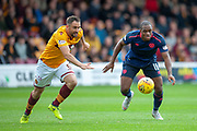 Uche Ikpeazu (#19) of Heart of Midlothian and Peter Hartley (#6) of Motherwell FC during the Ladbrokes Scottish Premiership match between Motherwell and Heart of Midlothian at Fir Park, Motherwell, Scotland on 15 September 2018.