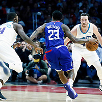 31 December 2017: LA Clippers guard Lou Williams (23) drives past Charlotte Hornets forward Michael Kidd-Gilchrist (14) on a screen set by LA Clippers forward Blake Griffin (32) during the LA Clippers 106-98 victory over the Charlotte Hornets, at the Staples Center, Los Angeles, California, USA.