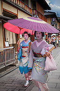 Geisha and 'maiko' (geisha apprentice) in Hanamikoji dori street.Geisha's distric of Gion.Kyoto. Kansai, Japan.