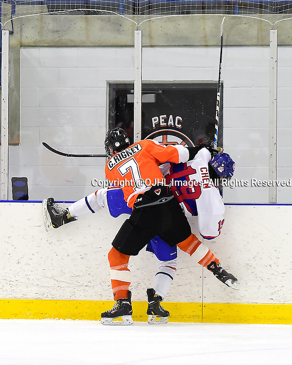 TORONTO, ON - Feb 8, 2015 : Ontario Junior Hockey League game action between Orangeville and Toronto, Colin Rigney #7 of the Orangeville Flyers makes the hit on Ian Chen #19 of the Toronto Canadiens during the second period.<br /> (Photo by Andy Corneau / OJHL Images)