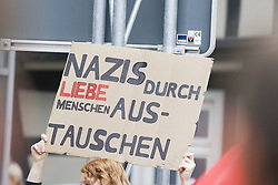 October 6, 2018 - Kandel, Rhineland-Palatinate, Germany - An anti-fascist protester holds up a sign that reads 'Replace Nazis with kind people'. Around 300 people from right-wing organisations protested for the 14. time in the city of Kandel in Palatinate against refugees, foreigners and the German government. They called for more security of Germans and women from the alleged increased violence by refugees. The place of the protest was chosen because of the 2017 Kandel stabbing attack, in which a 15 year old girl was killed by an asylum seeker. They were confronted by around 400 anti-fascist counter-protesters from different political parties and organisations. (Credit Image: © Michael Debets/Pacific Press via ZUMA Wire)