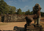 This image of the Terrace of the Leper King, a double terrace wall at the north end of the  Terrace of Elephants with deeply carved nagas, demons and other mythological beings was shot from atop the Terrace of Elephants in Angkor Thom city, part of the Angkor complex in Siem Reap, Cambodia that includes the world's largest single religious monument, the breathtaking Angkor Wat. <br /> <br /> Angkor Thom city, at the center of which lies the amazing Bayon temple is the last and most enduring city of the Khmer empire. It was built by King Jayavarman VII as a fortified city of almost 4 sq miles or 10 sq km on the right bank of the Siem Reap River, a tributary of Tonle Sap Lake.<br /> <br /> It has been featured in many book, films and video games of pop culture most notably in the Angelina Jolie film, Lara Croft: Tomb Raider.
