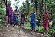 Masai children in the forest the Ngorongoro Conservation Area or NCA is a conservation area situated 180 km west of Arusha in the Crater Highlands area of Tanzania.