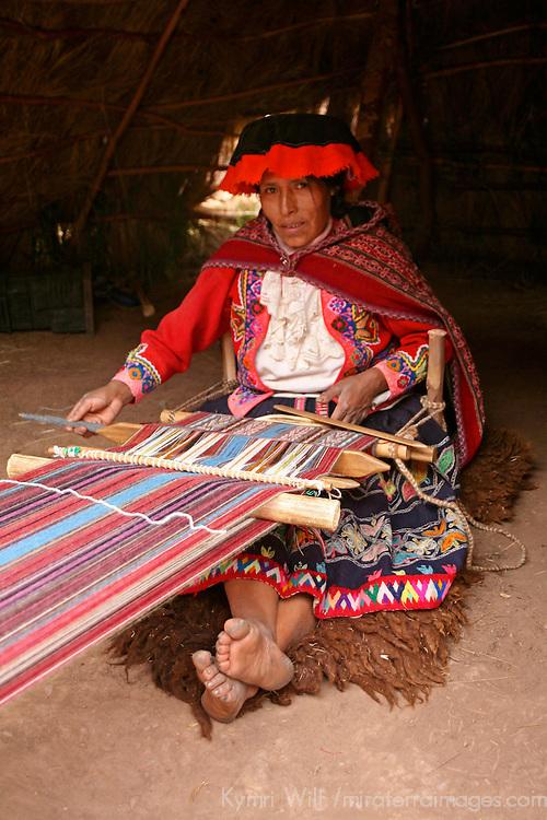 Americas, South America, Peru, Cusco. Woman waeving at Awana Kancha.