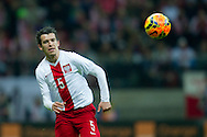 Poland's Waldemar Sobota fights for the ball during international friendly soccer match between Poland and Scotland at National Stadium in Warsaw on March 5, 2014.<br /> <br /> Poland, Warsaw, March 5, 2014<br /> <br /> Picture also available in RAW (NEF) or TIFF format on special request.<br /> <br /> For editorial use only. Any commercial or promotional use requires permission.<br /> <br /> Mandatory credit:<br /> Photo by © Adam Nurkiewicz / Mediasport