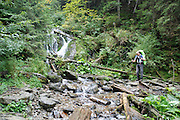 Romania, tourist hikes across a stream