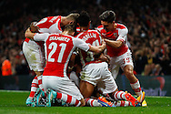 Alexis Sanchez of Arsenal celebrates scoring the opening goal against Southampton with team mates during the Capital One Cup match at the Emirates Stadium, London<br /> Picture by David Horn/Focus Images Ltd +44 7545 970036<br /> 23/09/2014