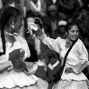 A young woman dances traditional Amayran dance in the El Alto, a city high above the city of La Paz populated almost entirely by indigenous Aymaran & Quechuan indians who have migrated to the urban centre.