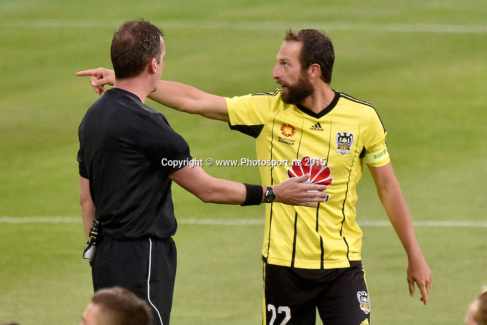 Andrew Durante captain of the Phoenix discusses yellow cards with the ref Peter Green during the A-League - Wellington Phoenix v Sydney FC football match at Westpac Stadium in Wellington on Sunday the 19th of December 2015. Copyright Photo by Marty Melville / www.Photosport.nz