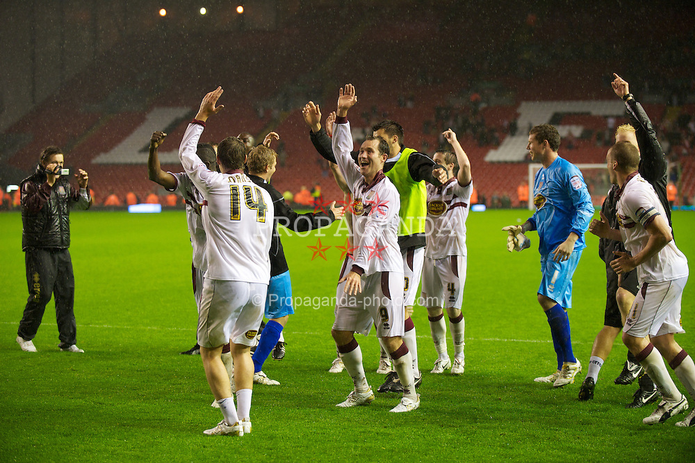 LIVERPOOL, ENGLAND - Wednesday, September 22, 2010: Northampton Town's Stephen Guinan and team-mates celebrate a famous victory over Liverpool after a penalty shoot-out during the Football League Cup 3rd Round match at Anfield. (Photo by David Rawcliffe/Propaganda)