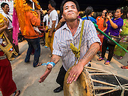 "05 APRIL 2015 - CHIANG MAI, CHIANG MAI, THAILAND: A man plays a traditional Shan drum during a parade of novice monks on the second day of the three day long Poi Song Long Festival in Chiang Mai. The Poi Sang Long Festival (also called Poy Sang Long) is an ordination ceremony for Tai (also and commonly called Shan, though they prefer Tai) boys in the Shan State of Myanmar (Burma) and in Shan communities in western Thailand. Most Tai boys go into the monastery as novice monks at some point between the ages of seven and fourteen. This year seven boys were ordained at the Poi Sang Long ceremony at Wat Pa Pao in Chiang Mai. Poy Song Long is Tai (Shan) for ""Festival of the Jewel (or Crystal) Sons.    PHOTO BY JACK KURTZ"