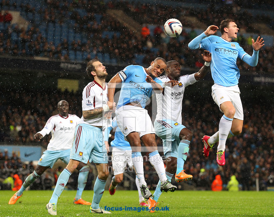 Picture by Paul Chesterton/Focus Images Ltd +44 7904 640267<br /> 08/01/2014<br /> Vincent Kompany of Man City in action during the Capital One Cup Semi Final 1st Leg match at the Etihad Stadium, Manchester.
