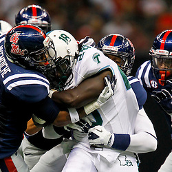 September 22, 2012; New Orleans, LA, USA; Tulane Green Wave running back Robert Kelley (28) is tackled by a group of Ole Miss Rebels defenders during the first quarter of a game at the Mercedes-Benz Superdome.  Mandatory Credit: Derick E. Hingle-US PRESSWIRE