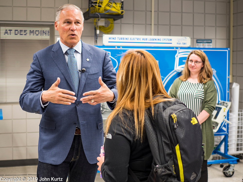 03 JUNE 2019 - ANKENY, IOWA: Governor JAY INSLEE, (D-WA), left, talks to a student in the wind turbine class during a tour at DMACC Monday. Governor Inslee is running to be the Democratic candidate for the US Presidency in 2020, He has made climate change a central point of his campaign and he toured a wind turbine program at the Des Moines Area Community College (DMACC) in Ankeny. Iowa generates more than 35% of its electrical needs through wind power. Iowa traditionally hosts the the first election event of the presidential election cycle. The Iowa Caucuses will be on Feb. 3, 2020.                        PHOTO BY JACK KURTZ