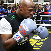 LAS VEGAS, NV - APRIL 14: WBC/WBA welterweight champion Floyd Mayweather Jr. works out with co-trainer Nate Jones at the Mayweather Boxing Club on April 14, 2015 in Las Vegas, Nevada. Mayweather will face WBO welterweight champion Manny Pacquiao in a unification bout on May 2, 2015 in Las Vegas.  (Photo by Alex Menendez/Getty Images) *** Local Caption *** Floyd Mayweather Jr., Nate Jones